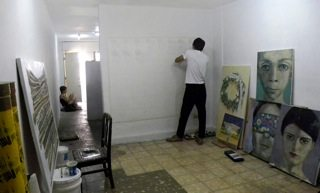 Cuban Artist working in private studio.